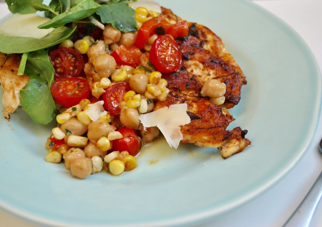 Lifestyle Blogger Jenny Meassick of the Weekend Blog, Chocolate and Lace shares her easy and delicious recipe for Grilled Chicken Cutlets with Cherry Tomato, Corn and Chickpea Sauce.