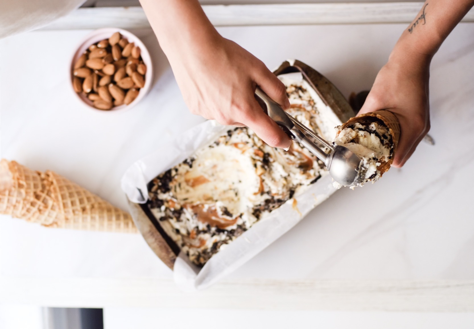 Lifestyle Blogger Chocolate and Lace shares her recipe for Oreo Salted Almond Caramel Swirl Homemade Ice Cream.