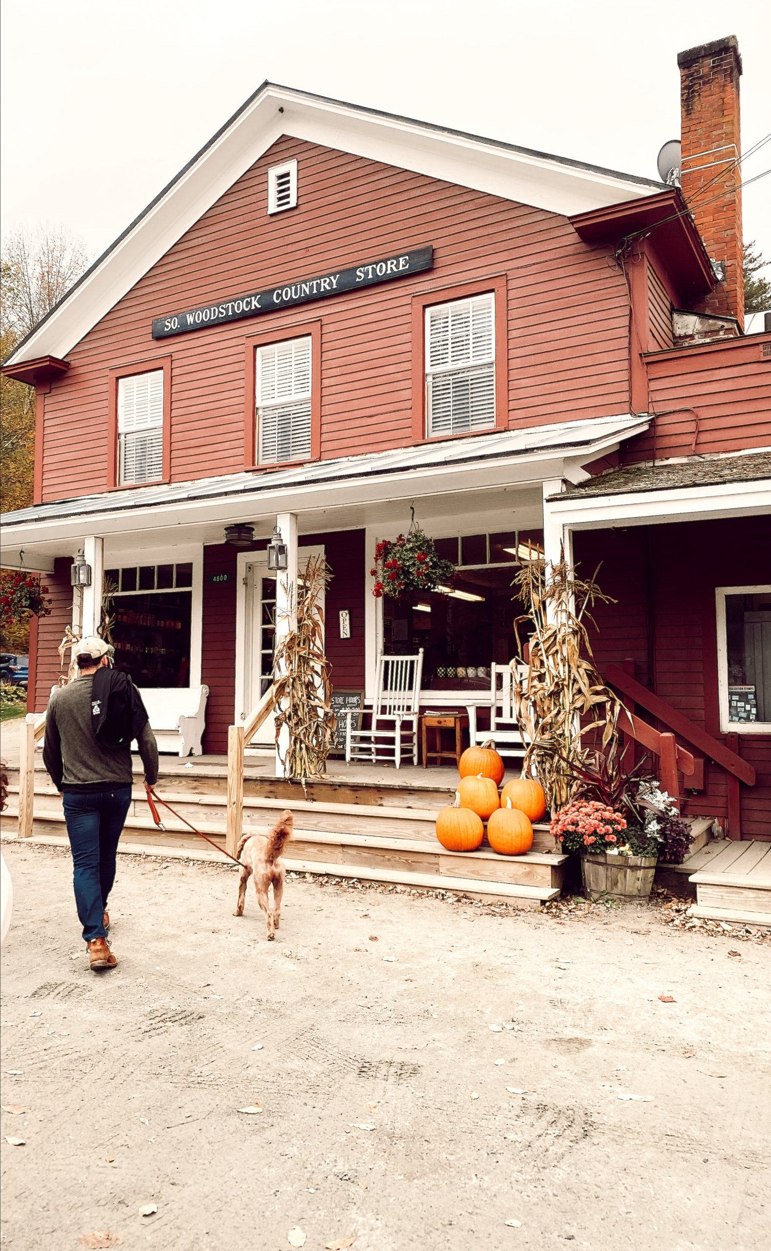 a red country store that says woodstock country store